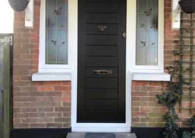 Black composite door fitted in Broadstone
