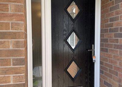 Black composite doors 3 triangle style Dorset
