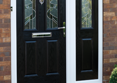 Black Composite door and matching composite sidelight. Two panel two square with Zinc Art Abstact glass design in both.