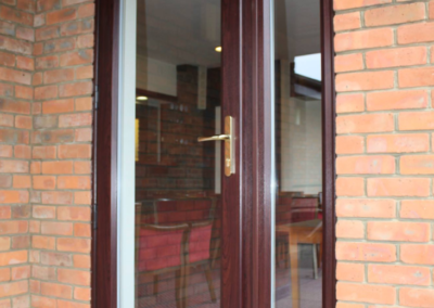 Rosewood UPVC door, white inside, fitted in Broadstone, Dorset