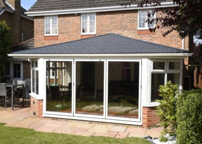 Ultra Tiled roof with aluminium bi fold doors Dorset